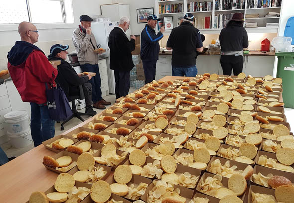 Lining up for supplied lunches at the Shedders day